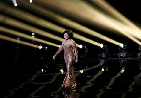"Dame Shirley Bassey performs the song ""Goldfinger"" during a tribute to the James Bond films at the 85th Academy Awards in Hollywood"