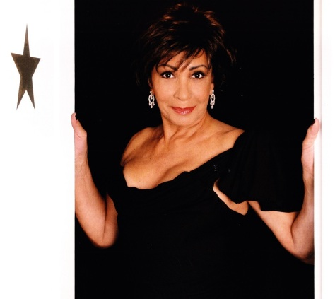 Dame Shirley Bassey looked sexy and mysterious in her black Vivienne Westwood dress
