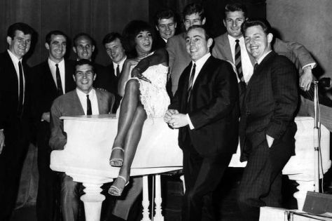 Shirley Bassey giving a farewell song to Liverpool football players on the evening of their departure to Milan for a European Cup game. With Ron Yeats on piano, the team sang one of Shirley's numbers, 'As long as he needs me' 10th May 1965.